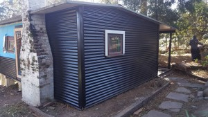 new colourbond cladding is joined to existing areas of colourbond that are still in good condition