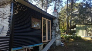 the original chimney was one of the reasons the client decided not to knock down the shack