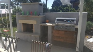 the final coat of render on the outdoor oven is completed